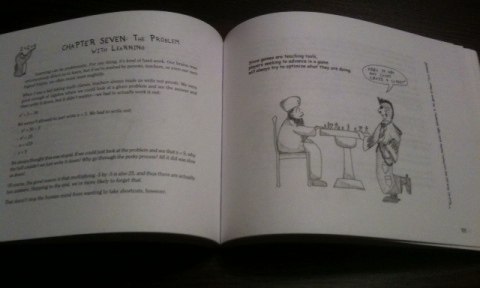 The open book, with text on the left half and a cartoon on the right